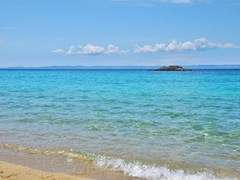 Kalogria beach in Sithonia, Chalkidiki, Greece, with a view on Kassandra peninsula.