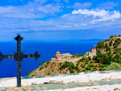 Iron-cross-against-a-blue-sky-on-Mount-Athos,-Greece