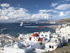 12_Mykonos-Cruise-ships-docked-at-a-port-on-the-shoreline-of-Mykonos,-Greece.