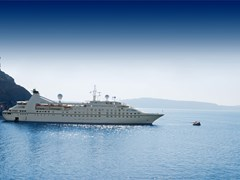 35_luxury-white-cruise-ship-on-a-clear-day-with-calm-seas-and-blue-sky-on-the-greek-island-of-santorini
